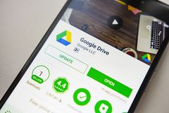 Berlin, Germany - November 19, 2017: Google Drive application on screen modern smartphone in Play Store. Google apps. Berlin, Germany - November 19, 2017 Stock Images