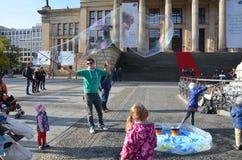 Berlin, Germany - November 03, 2014: Man makes soap bubles royalty free stock photos
