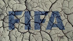 Mud Cracks Symbolizing The Crisis of FIFA. BERLIN, GERMANY - NOVEMBER 22, 2018: Mud Cracks Symbolizing The Crisis of FIFA royalty free stock images