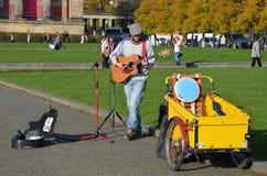 Berlin, Germany - November 03, 2014: Musician playing the guitar at city park royalty free stock photo