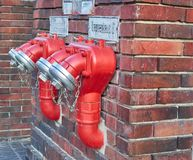 Berlin, Germany - November 29, 2018: red double watery on a brick wall view from the side stock images