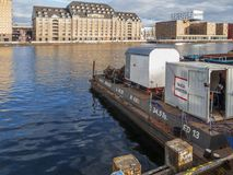 Pontoon of a mobile industrial diver. Berlin, Germany - November 18, 2016: View from Kreuzberger Spree shore with mobile industrial diver station in the Royalty Free Stock Photography