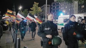 Berlin, Germany - October 2018: The demonstration with the flags of the  German Republic and the Third Reich neo-Nazis in