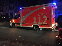 German ambulance at night. Berlin, Germany - October 20, 2018: German ambulance first aid. 112 is the single European emergency number that can be dialed free of stock photos