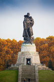 BERLIN, GERMANY - OCTOBER 02, 2016: Monument to Soviet soldier holding at the hands German child at Soviet War Memorial Stock Photos