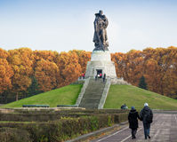 BERLIN, GERMANY - OCTOBER 02, 2016: Monument to Soviet soldier holding at the hands German child at Soviet War Memorial Royalty Free Stock Image