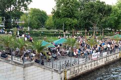 Berlin, Germany, May, 2018: People enjoying summer in Monbijou park on the bank of the river Spree royalty free stock photography