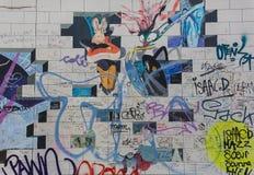 BERLIN, GERMANY - SEPTEMBER 15: Berlin Wall graffiti seen on SEPTEMBER 15, 2014, Berlin, East Side Gallery. It`s a 1.3 Royalty Free Stock Photography