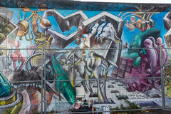 BERLIN, GERMANY - SEPTEMBER 15: Berlin Wall graffiti seen on SEPTEMBER 15, 2014, Berlin, East Side Gallery. It`s a 1.3 Royalty Free Stock Photography
