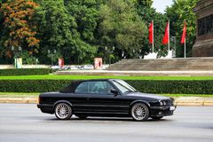 BMW E30 3-series. Berlin, Germany - September 10, 2013: Black car BMW E30 3-series in the city street Royalty Free Stock Photos