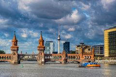 BERLIN, GERMANY - SEPTEMBER 21, 2015 - Spree River in the inner. BERLIN, GERMANY - SEPTEMBER 21, 2015: the bridge Oberbaumbrucke over the Spree, connects the Royalty Free Stock Photo