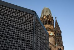 Broken tower of Kaiser Wilhelm Memorial Church Gedachtniskirche with belfry in front - church was not rebuild as a reminder of w stock images