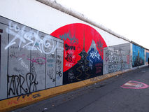 BERLIN, GERMANY - SEPTEMBER 22: Graffiti on Berlin Wall at East Side Gallery on September 22, 2014 in Berlin Stock Image
