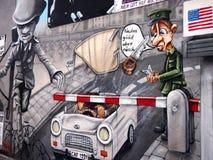 BERLIN, GERMANY - SEPTEMBER 22: Graffiti on Berlin Wall at East Side Gallery on September 22, 2014 in Berlin. Royalty Free Stock Photos
