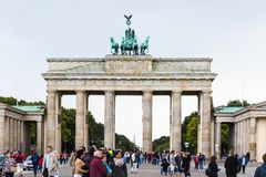 Many tourists near Brandenburg gate in Berlin. BERLIN, GERMANY - SEPTEMBER 13, 2017: many tourists near Brandenburg gate Brandenburger Tor in Berlin city in stock photo