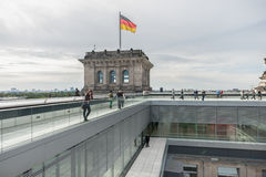 BERLIN, GERMANY - SEPTEMBER 26, 2012: Roof of the Reichstag Building in Berlin, Germany with tourist People. Stock Photos