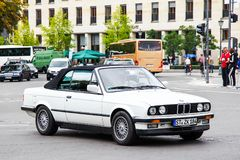 BMW E30 3-series. Berlin, Germany - September 12, 2013: White car BMW E30 3-series in the city street Stock Images