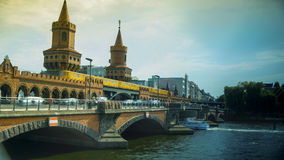 Berlin, Germany: Yellow subway train on famous Oberbaum bridge. Stock Photography