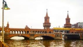 Berlin, Germany: Yellow subway train on famous Oberbaum bridge. Berlin, Germany: Yellow subway train on Oberbaum bridge Stock Photo