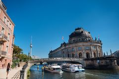 Berlin government district with Bode museum and ship on Spree rive royalty free stock photo