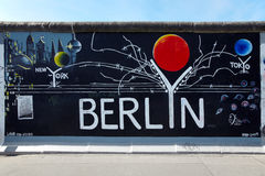 Berlin graffiti at East Side Gallery Royalty Free Stock Photography