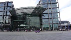 Berlin Hauptbahnhof, Central Railway Station. Berlin Hauptbahnhof, Germany, April 15 2018: Commuters going to entrance of Deutsche Bahn Central Railway Station stock video footage