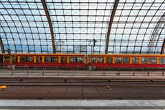 Berlin hbf train station Germany 31-8-2018. View of the glass roof of the station with a train parked at the end. in the foregrou. Nd the rails. The contours of stock image