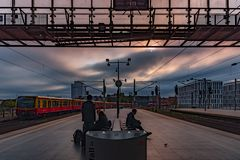 Berlin hbf train station Germany 31-8-2018. View of the platform where people wait for the train, in the early morning at sunrise stock photography