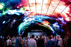 Berlin IFA Fair: Crowds looking at Oled TV. Crowds survey LG Oled TV on IFA Berlin. IFA Berlin is the worlds leading trade show for consumer electronics and home Royalty Free Stock Photo