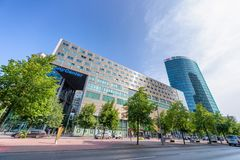 BERLIN - JULY 24, 2016: Potsdamer Platz modern buildings against. Blue sky. It is located in the Mitte district and is an attraction for tourists from around royalty free stock photography