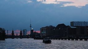 Berlin, Kreuzberg, Spree vie with boat - Evening stock footage