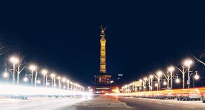 Light trails towards one of the landmarks in Berlin. Long exposure night photo in Berlin, light trails created by the Stock Photography