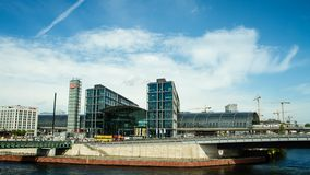 Berlin Main Station time lapse. Establishing time lapse shot of the Berlin Main Station as seen from across the river Spree stock footage