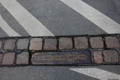 Berlin Mauer Memorial. Mark of remains of berlin wall, Gemany. Place of the Berlin wall until 1989, now there is the street Stock Photo