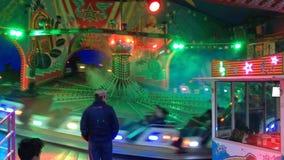 Funfair Ride (Fahrgeschaeft) `Melodie Star` at German Fun Fair Kirmes in Berlin - Medium Wide Shot stock video