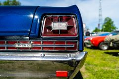 Rear stoplight of the full-size car Ford Galaxie 500, close-up. BERLIN - MAY 05, 2018: Rear stoplight of the full-size car Ford Galaxie 500, close-up royalty free stock images