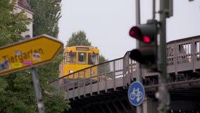 Berlin metro on elevated railway pass by. It is evening in Kreuzberg, an alternative district of Berlin stock footage