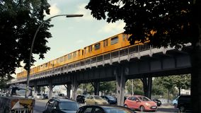 Berlin metro train passing by in sunny weather, cars parking below. Metro train passing by in sunny weather, cars parked below in Berlin, Germany, Europe stock video footage