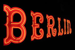 Berlin neon sign. Glowing Berlin neon sign on a black background stock photo