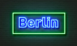 Berlin neon sign on brick wall background. Stock Image