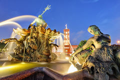 Berlin Neptune fountain in Alexanderplatz With Rotes Rathaus Stock Photos