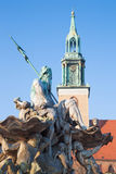 Berlin - The Neptune Fountain Neptunbrunnen and the Marienkirche church designed by Reinhold Begas in 1891 Royalty Free Stock Photos