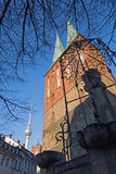 Berlin - The Nikolaikirche church and the Fernsehturm in the backgroud in evening light.  Royalty Free Stock Images