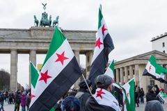Protest action of the Syrian opposition near Brandenburg Gate. BERLIN - NOVEMBER 12, 2017: Protest action of the Syrian opposition near Brandenburg Gate against Royalty Free Stock Photos