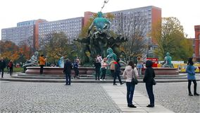 Berlin - November 2017: tourists strolling along Alexanderplatz near the monument to Neptune stock video footage