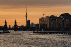 Berlin oberbaumbrucke with tv tower at sunset. Germany Royalty Free Stock Image