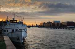 Berlin oberbaumbrucke and tv tower with white boat. At sunset Royalty Free Stock Photos