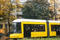 Berlin, October 2, 2017: City public transport in Germany. Beautiful black and yellow train stopped at stop on the Stock Images