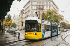 Berlin, October 2, 2017: City public transport in Germany. Beautiful black and yellow train stopped at stop on the. Background of an old building Royalty Free Stock Photo