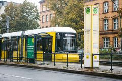 Berlin, October 2, 2017: City public transport in Germany. Beautiful black and yellow train stopped at stop on the Stock Photos